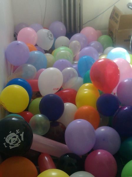 Office filled with balloons for prank
