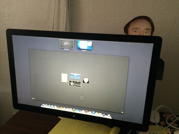 Printout of Nicholas Cage behind monitor for prank
