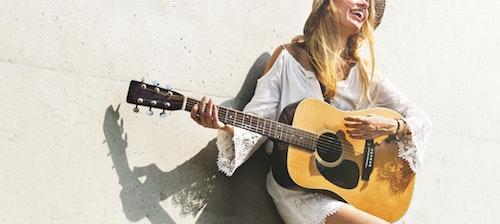 girl holding guitar