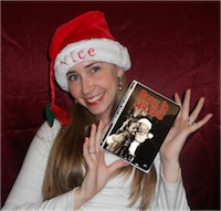 Author Robyn Norgan holding holiday movie whilst wearing a Santa hat