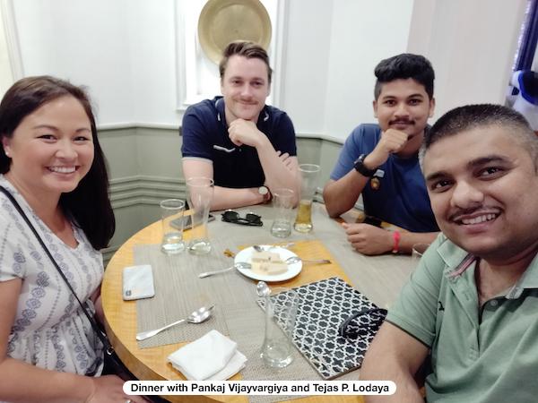 Four people having dinner
