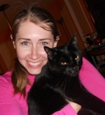 Author Robyn Norgan with a black cat