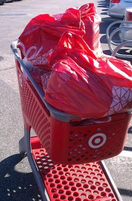 Target shopping cart filled with gifts for Adopt-a-Family program