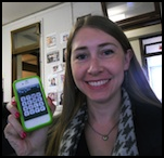 Author Robyn Norgan holding a smartphone