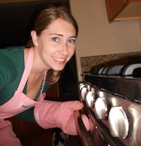 Author Robyn Norgan opening oven