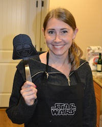 Robyn Norgan grilling with Star Wars apron & Darth Vader spatula