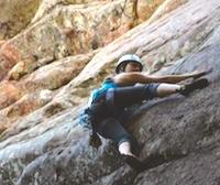 A rock climber scaling a rock face