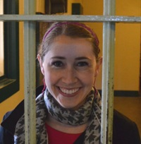 The author Robyn Norgan behind bars