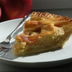 A slice on apple pie on a side plate