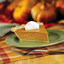 A slice of pumpkin pie on a side plate