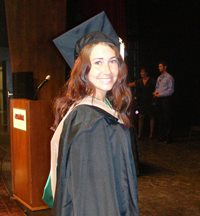 The author Robyn Norgan in graduation garb