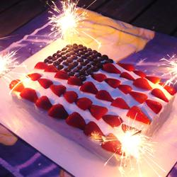 A cake decorated in the likeness of the American flag