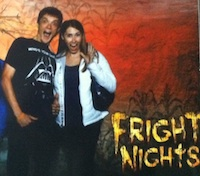 The author Robyn Norgan and a man posing at a haunted house